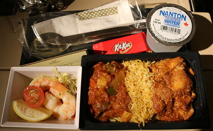 My special seafood meal consisted of what seemed to be a fish curry with rice and stewed mixed vegetables; two large shrimp as an appetizer; and an American KitKat chocolate bar for dessert. Photograph ©2015 by Brian Cohen.