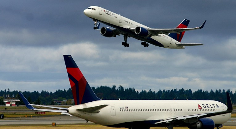 Delta Air Lines airplanes on runway and tarmac in Seattle