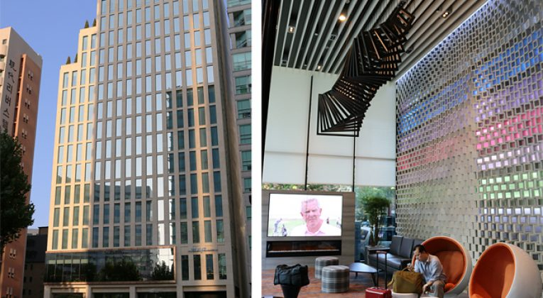 The photograph on the left shows the exterior of the Aloft Seoul Gangnam hotel property; while the photograph on the right shows the lobby to the left of the entrance. The furnishings in the lobby were stylish; but they were not very comfortable. Photographs ©2014 by Brian Cohen.