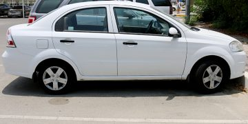 Avis white rental car