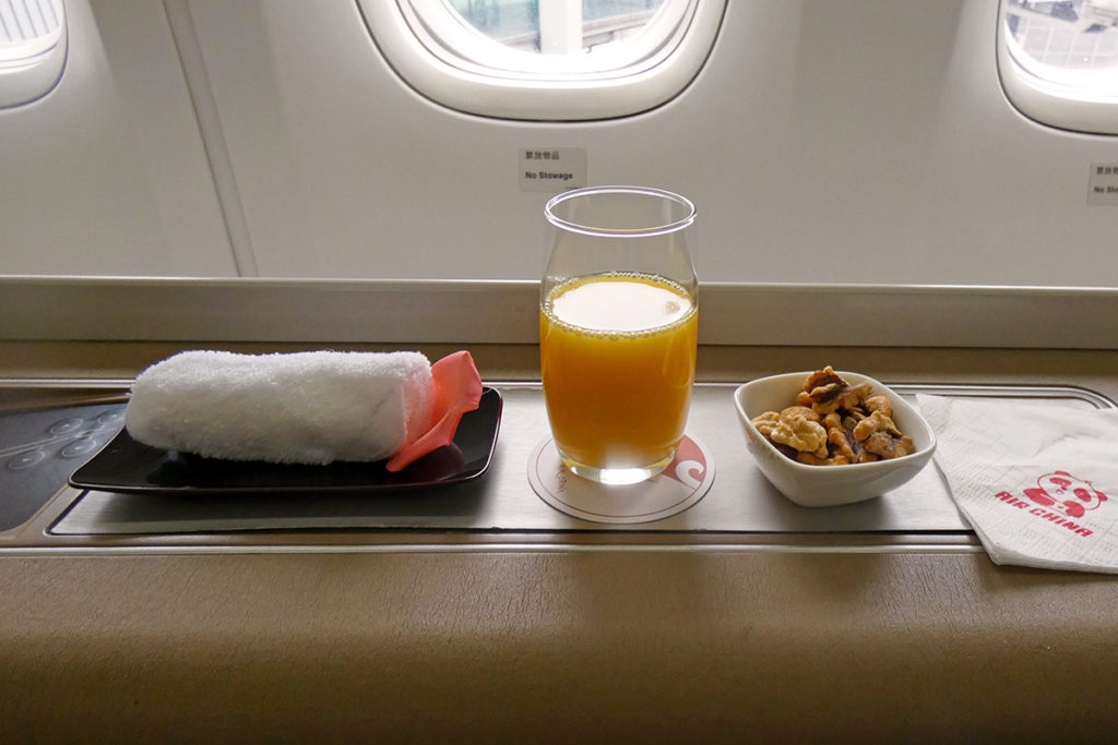 Hot towel, orange juice and nuts