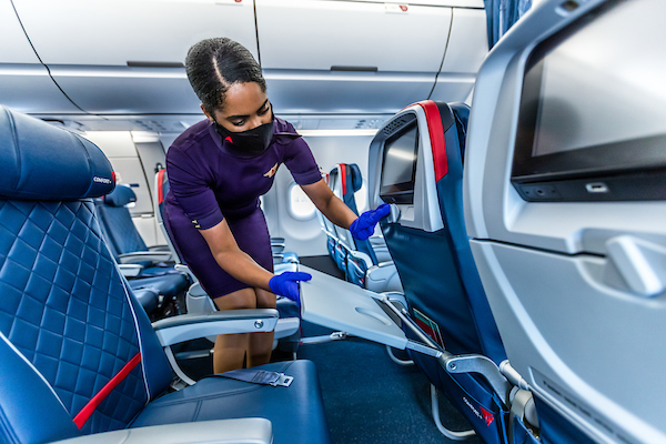 Flight attendant cleaning on board (Source: Delta)